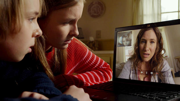 Two children videochat with their mom